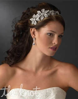 Rhodium silver plated headband features rhinestones.