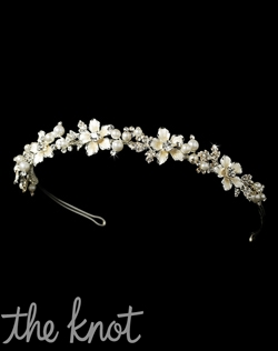 Silver plated headband features faux pearls and rhinestones.