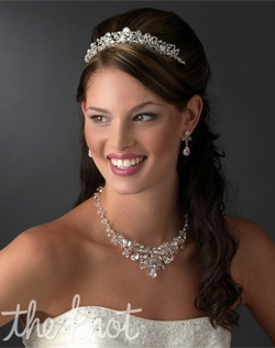 Sterling silver plated tiara features rhinestones and Swarovski crystals. Matching rhinestone and Swarovski crystal jewelry set also available.