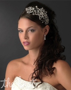 Rhodium plated headband features rhinestones.