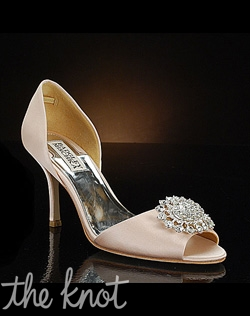 Pink D'Orsay shoe features rhinestone brooch at toe.