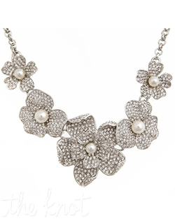 "Silver necklace features Swarovski crystals and synthetic pearls in flower design. Center flower is 2"" L. Necklace adustable from 15"" - 19"""