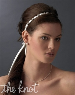 White or ivory satin ribbon headband embellished with rhinestones.