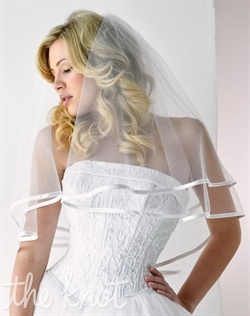 Elbow-length tulle veil features two tiers and satin trim. Available in various colors and lengths upon request. 24&quot;/30&quot; L