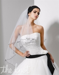 "Fingertip-length tulle veil features two tiers and hand-beaded Swarovski crystals. Available in various colors and lengths upon request. 30""/42"" L"