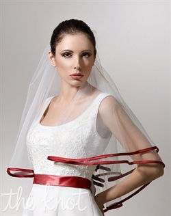 "Elbow-length tulle veil features two tiers and satin trim. Available in various colors and lengths upon request. 24""/30"" L"