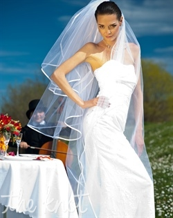 "Cathedral-length tulle veil features three tiers and satin trim. Available in various colors and lengths upon request. 25""/45""/108"" L"