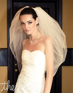 "Elbow-length tulle veil features two tiers. Available in various colors and lengths upon request. 29""/33"" L"