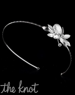 Silver-plated headband features rhinestones.