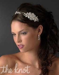 Headband features floral design encrusted with rhinestones and Swarovski crystals.
