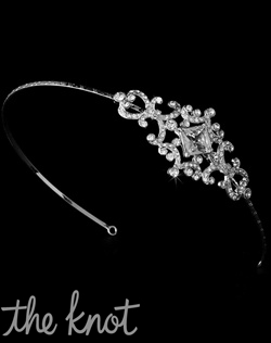 Silver-plated headband features rhinestone encrusted accent on side.
