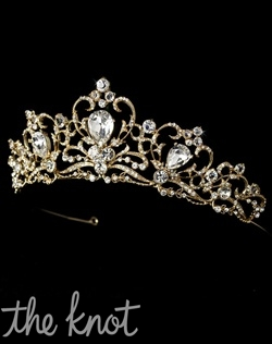 Silver or gold-plated crown features rhinestones with scroll pattern.