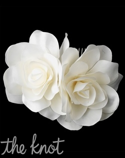 White or ivory comb features two silk flower roses.