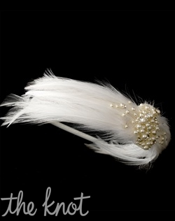 White or ivory satin headband features feathers, faux pearls, and rhinestones.