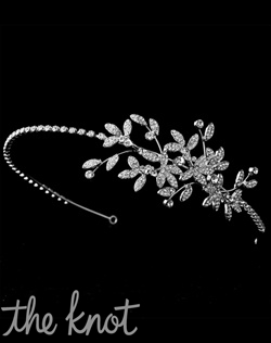 Silver-plated headband features rhinestone floral pattern.