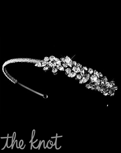 Silver-plated headband features chunky rhinestones.