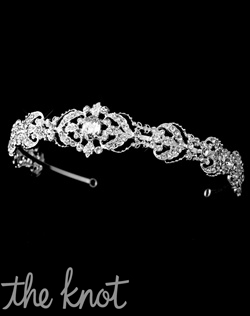Silver-plated headband features rhinestones and scroll pattern.