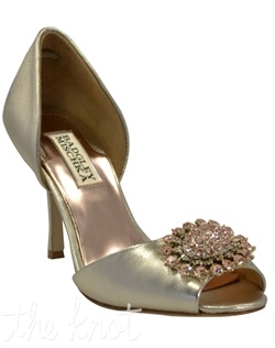Golden platinum pump features crystal brooch. Sizes 6, 6.5, 7, 8, 8.5, 9, 10