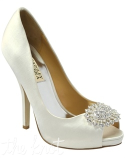 Diamond white silk platform pump features crystal brooch. Sizes 7.5-8.5, 10