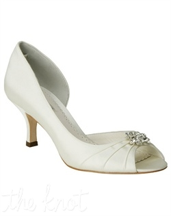 White or ivory Duchesse silk pump features crystal brooch. Sizes 6-10