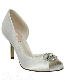 White or ivory satin pump features crystal brooch. White is dyeable. Sizes 5, 6-10