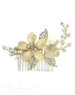 Comb features flower detail with crystal center and crystal encrusted leaves.