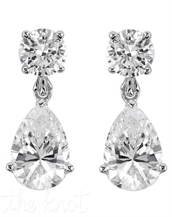 Sterling silver and platinum earrings feature teardrop cubic zirconias.