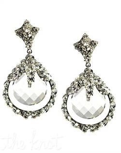 Silver earrings feature multi-cut crystal centers surrounded by crystal hoops.