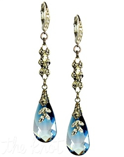 Silver French hook earrings feature blue or clear Swarovski crystals and crystal filigree.