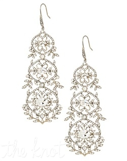 Silver earrings feature crystals.