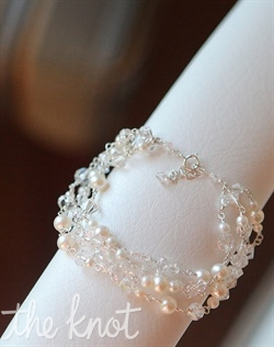 Adjustable sterling silver or 14k gold-filled bracelet features pearls and crystals. Crystals available in various colors.