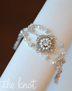 Adjustable sterling silver bracelet features pearls, crystals, and rhinestones. Crystals available in various colors.