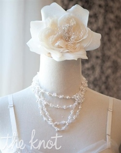 Adjustable silver necklace features pearls, crystals, and vintage rhinestone brooch. Crystals available in various colors.