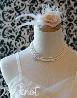 Silver necklace features Swarovski pearls and vintage brooch accent. Available in white, ivory, or diamond white.