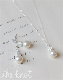 "Sterling silver or 14k gold-filled necklace and earrings feature Swarovski pearls and rhinestones. Available in white or ivory. Adjustable 16"" - 18"""