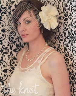 Fascinator features silk poppy flower and vintage brooch. Available in ivory, fuchsia, turquoise, or black. Birdcage veil sold seperately.