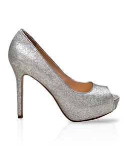 Platform pump features silver glitter. Also customizable in various colors, fabrics, and heel heights.