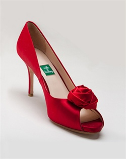 Crimson silk sandal features rosette detail.Also customizable in various colors, fabrics, and heel heights.
