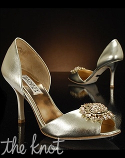 Platinum shoe features D'Orsay heel.