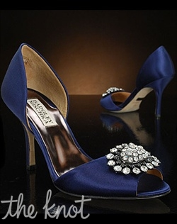 Navy blue D'Orsay shoe features silver brooch. Other colors available.
