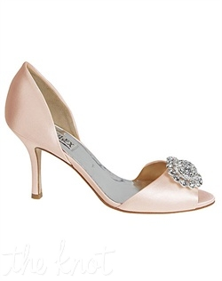 Light pink D'Orsay shoe features silver brooch.