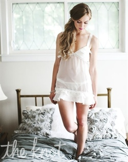 Ivory chiffon chemise features silk satin ties at shoulder and lace detail. S, M, L