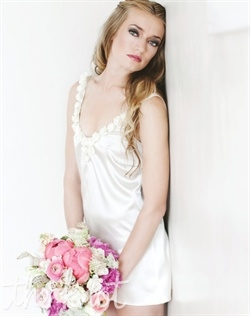 Ivory charmeuse chemise features silk satin ties at shoulder and rosette detail at neckline. S, M, L