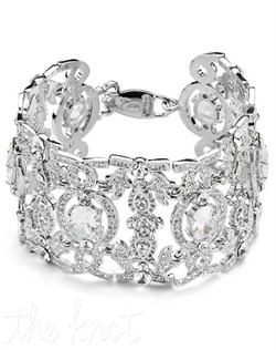 Rhodium-plated bracelet features Swarovski crystals and cubic zirconia. Also available in goldtone. 7&quot; L