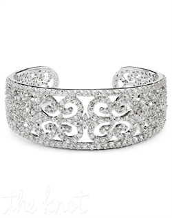 "Rhodium-plated bracelet features cubic zircona in scroll pattern. 7"" L"