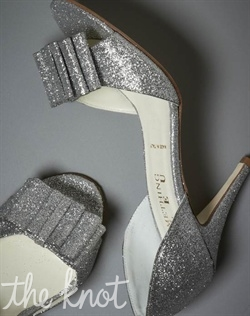 Silver glitter leather pump features bow detail and leather sole. Sizes 5 - 11