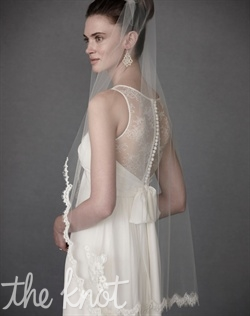 Ivory finger-tip length veil features lace and tulle.