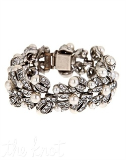 "Antiqued silver bracelet features Swarovski crystals and synthetic pearls. 7"" L"