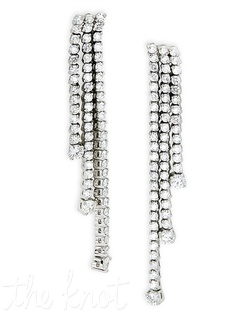 Earrings feature three graduated strands of diamonds in 2-prong settings and larger round diamond at bottom of each strand. Diamond TW: 3.33; 2-3/6&quot; length. Rental jewelry.