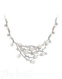 "18k white gold bib necklace features asymmetric shape, pearls, and diamonds. Diamond TW: 1.48; 17"" length; 1-1/2"" center length; 2-1/2"" center width. Rental jewelry."